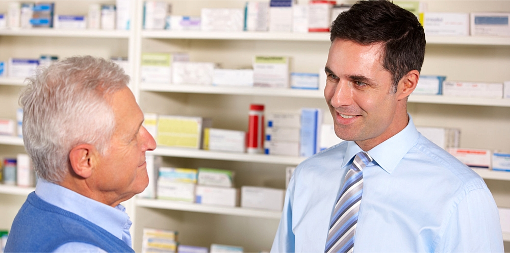 pharmacist smilng on the elder man